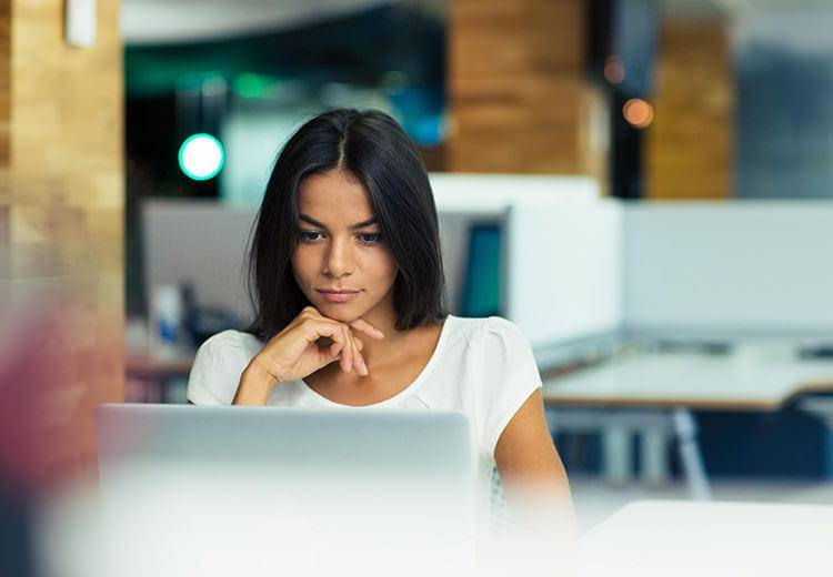 Woman with white t-shirt on her laptop