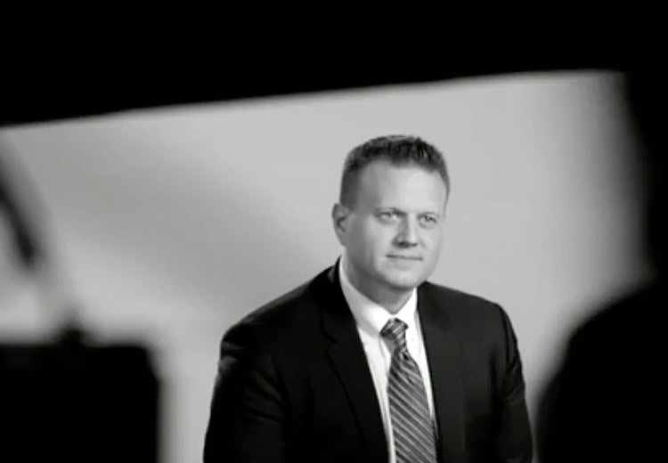 Black and white photo of a man in a suit