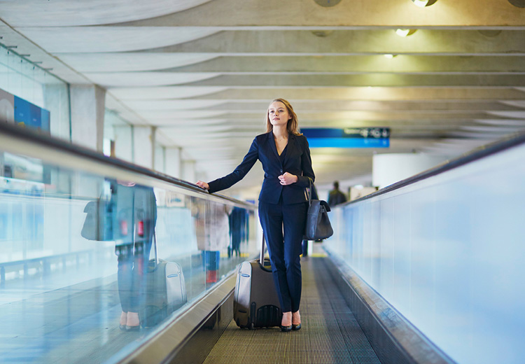Woman on a moving walkway