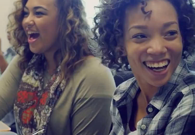 Two students laughing in class