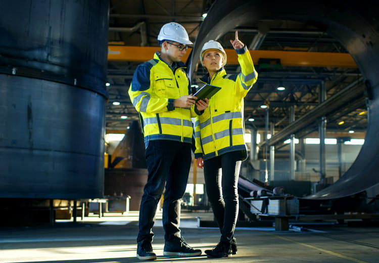 Two industrial workers in image used to promote FAQ about SAP Ariba Guided Sourcing