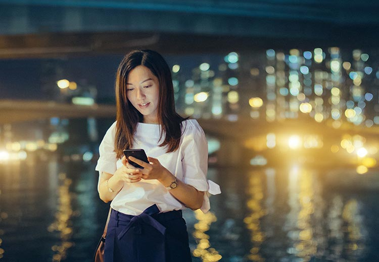 Girl in a white shirt on her phone