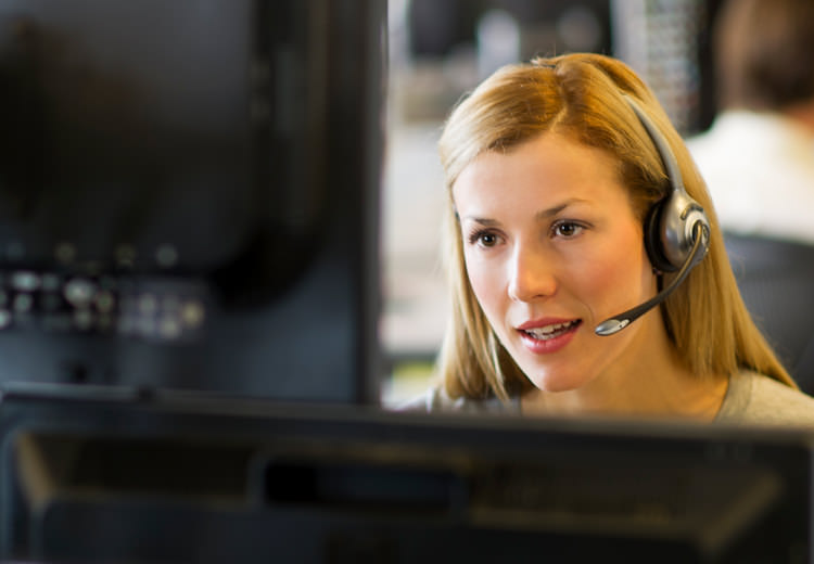 A customer service expert helps to answer a customer question