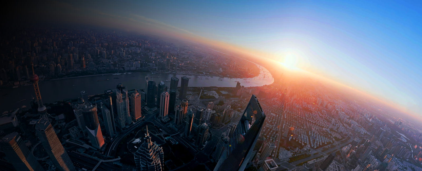 The sun rises over the Shanghai skyline