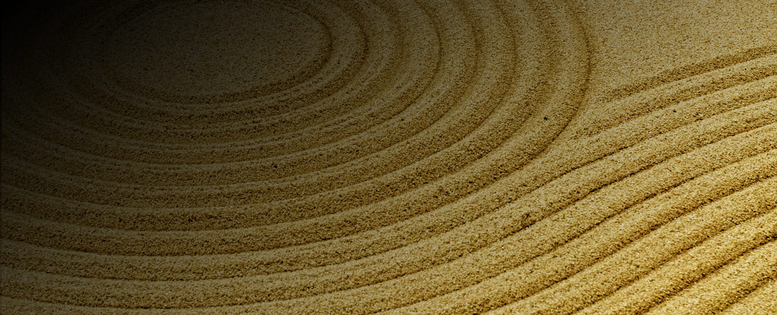 A repeating circular pattern etched into a zen sand garden