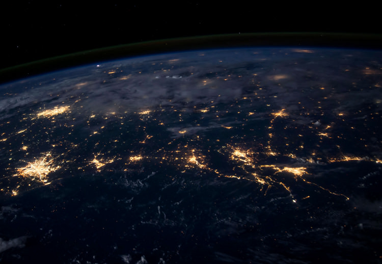 View of the Earth at night as city lights show the network grid
