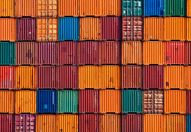 A large wall of multi-colored stacked shipping containers
