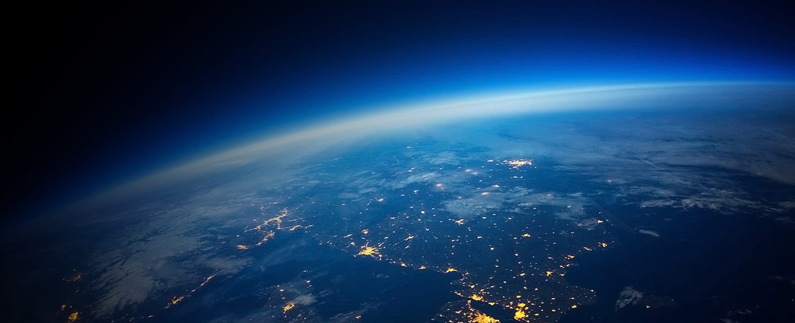 Wide shot of Earth at night